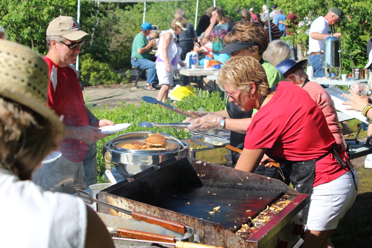 The Island Breakfast cooking team prepares to feed a new group