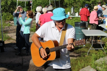 Doug Healy of Healy and Orr entertains on the banks of the St. Lawrence River