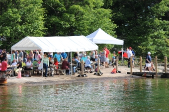 People enjoying breakfast on Refugee Island, Brockville, during Island Breakfast