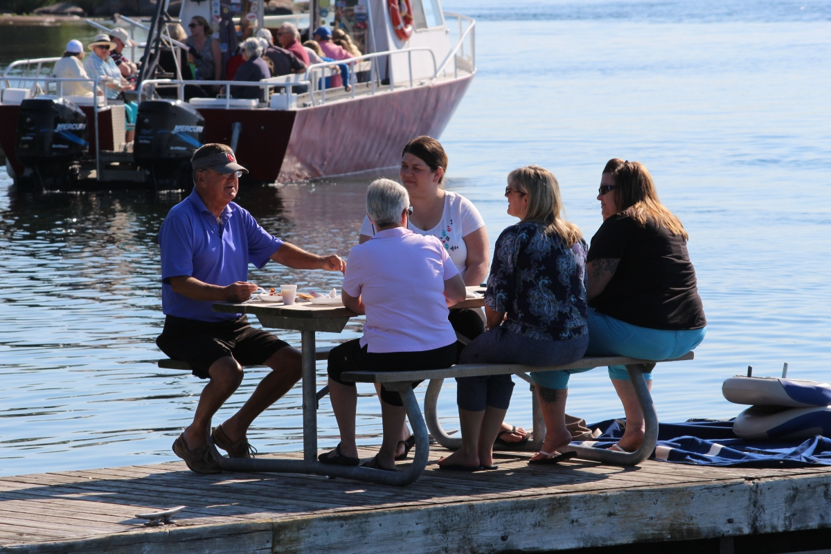A group enjoys breakfast on the dock