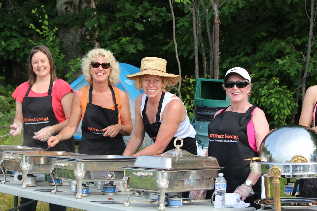 Volunteers at Island Breakfast serve up breakfast on Refugee Island